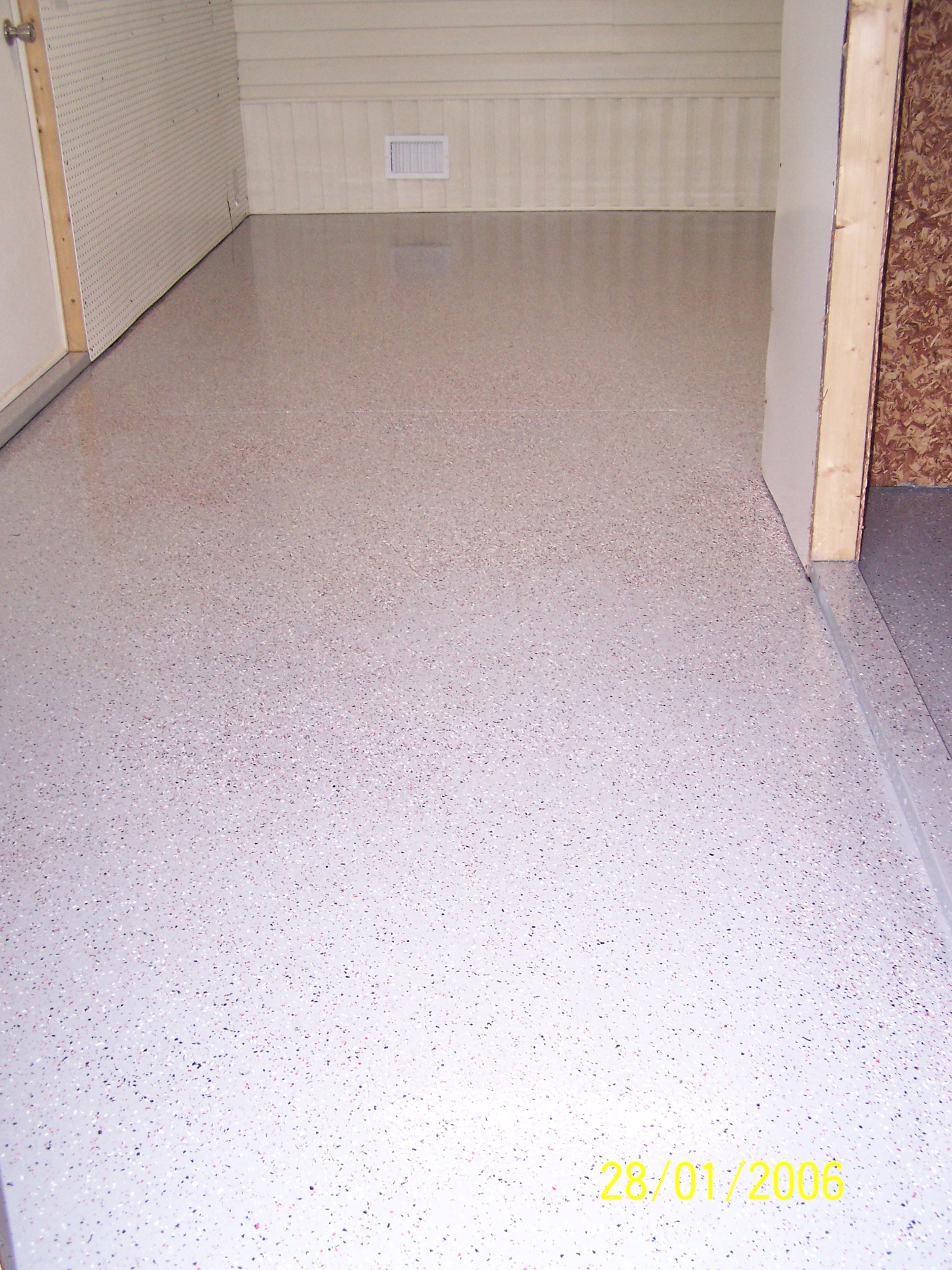 Garage floors epoxy decorative concrete tampa pasco for How to clean stamped concrete floors